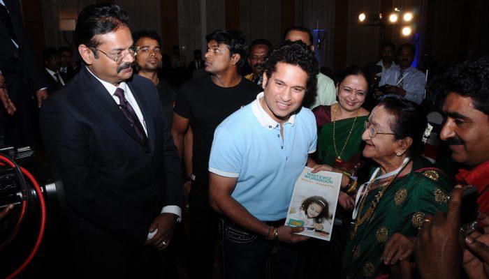 Sachin Tendulkar presenting Writewiz book to Dr. Mrs. Y. G. Parthasarathy